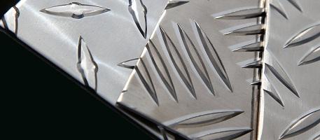 Лист стальной с чечевичным рифлением
