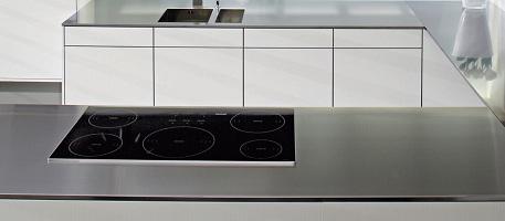 Нержавеющая сталь для столешниц в интерьере современной кухни